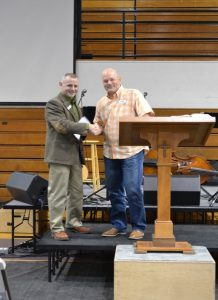 Lane County Sheriff Byron Trapp (l.) accepts a $5,000 check from Pastor Brett Gilchrist of the University Fellowship Church August 7th. (photo provided by Lane County Sheriff's Office)