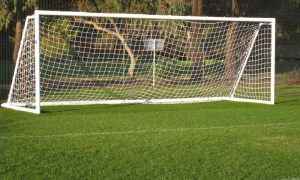 File photo of closeup of an empty goal on the soccer pitch.