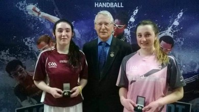 Aoife Holden (right) pictured receiving her medal at the All Ireland 40x20 colleges intermediates finals in February 2015.