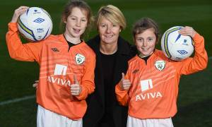 Former Ireland womens' manager Sue Ronan pictured with some of the Aviva Soccer Sisters at the Aviva Stadium