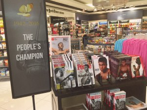 A display of commemorative magazines and books at Louisville's airport.