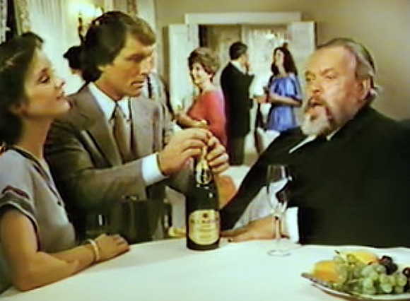 """Ahh, the French!"" Orson Welles enjoys some wine."