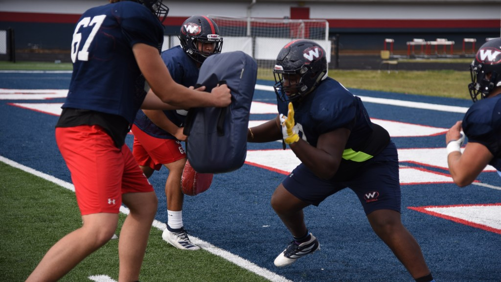 Tyrell Ragland, center, participates in offensive line drills during a practice at West High School on Oct. 15, 2019.