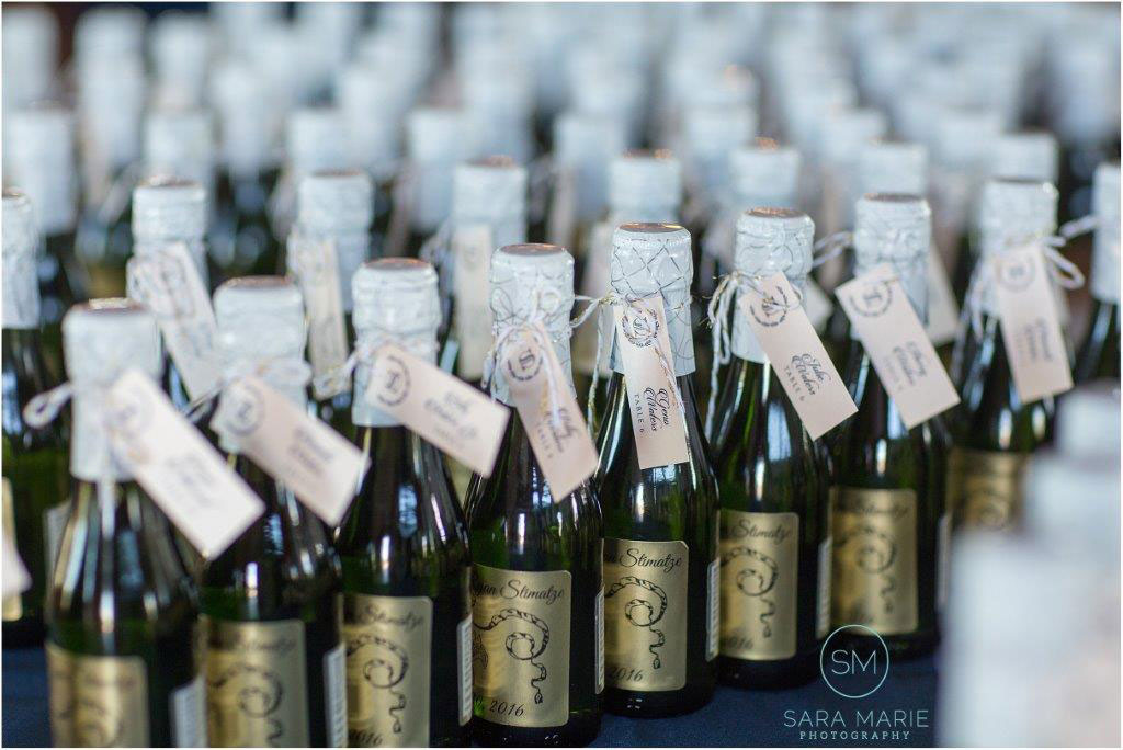 Champagne bottles set up for each table at wedding reception