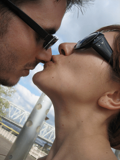 A close-up of a couple about to kiss