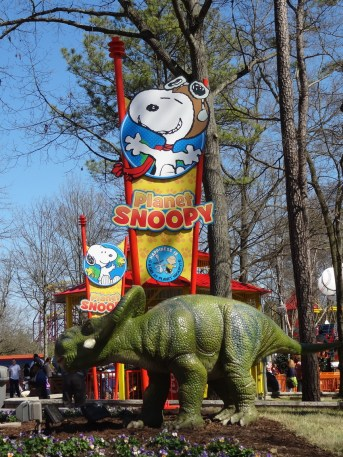 Planet Snoopy sign with a dinosaur
