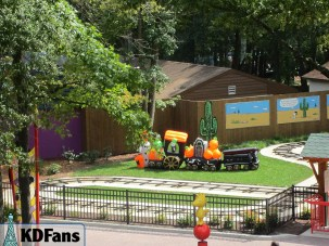There is a weird looking blow up train inside of Snoopy's Junction