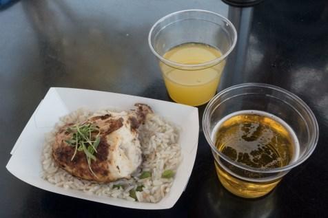 The jerk chicken alongside the booth's drink offerings