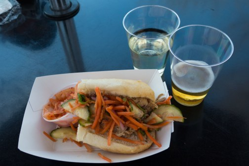 Kimchi sandwich alongside the booth's two drinks