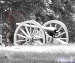 Appears to be a man standing in front of the cannon.