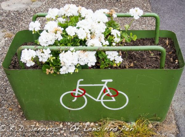 Flower pot with painted bicycle London