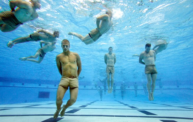 Wanna be a Navy Seal? You have to pass the drowing test. Just untie your hands and feet and swim to the top so you don't drown...Sweet.