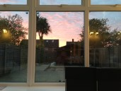 Sunset via the Conservatory - my backdrop most nights while sewing curtains.