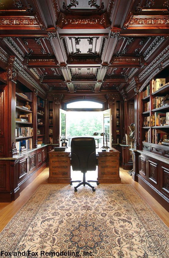 An extravagant home library that melds a home office with a library of our dreams.