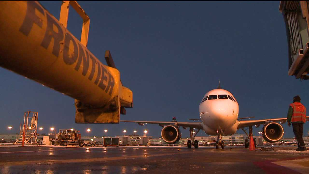 Frontier Airlines jet pulls into gate at Denver International Airport