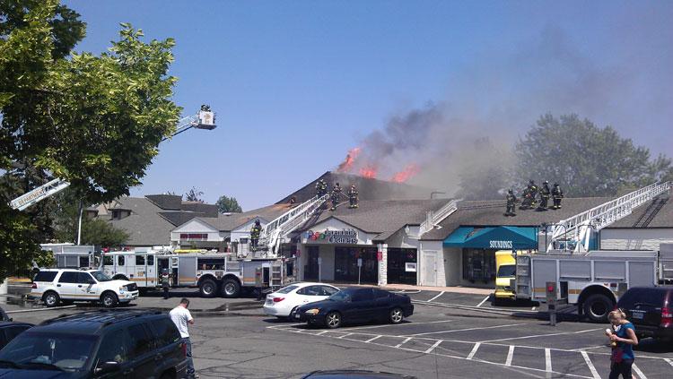 Fire at Denver Tech Center strip mall, Belleview & Ulster. July 12, 2012. Photo by: David Tschan