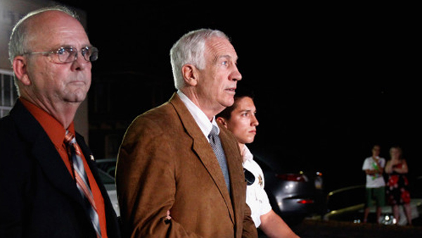 Former Penn State assistant football coach Jerry Sandusky leaves the Centre County Courthouse in handcuffs after a jury found him guilty in his sex abuse trial on June 22, 2012. (CNN)