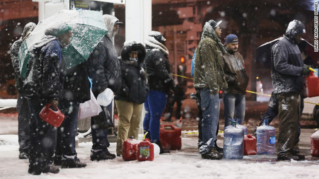 People wait in line to buy gasoline during the snowstorm on Wednesday night in Brooklyn. The city is still short on gas because of Superstorm Sandy (CNN)