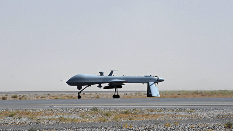 File photo of a US Predator unmanned drone armed with a missile. (Photo: MASSOUD HOSSAINI/AFP/Getty Images)