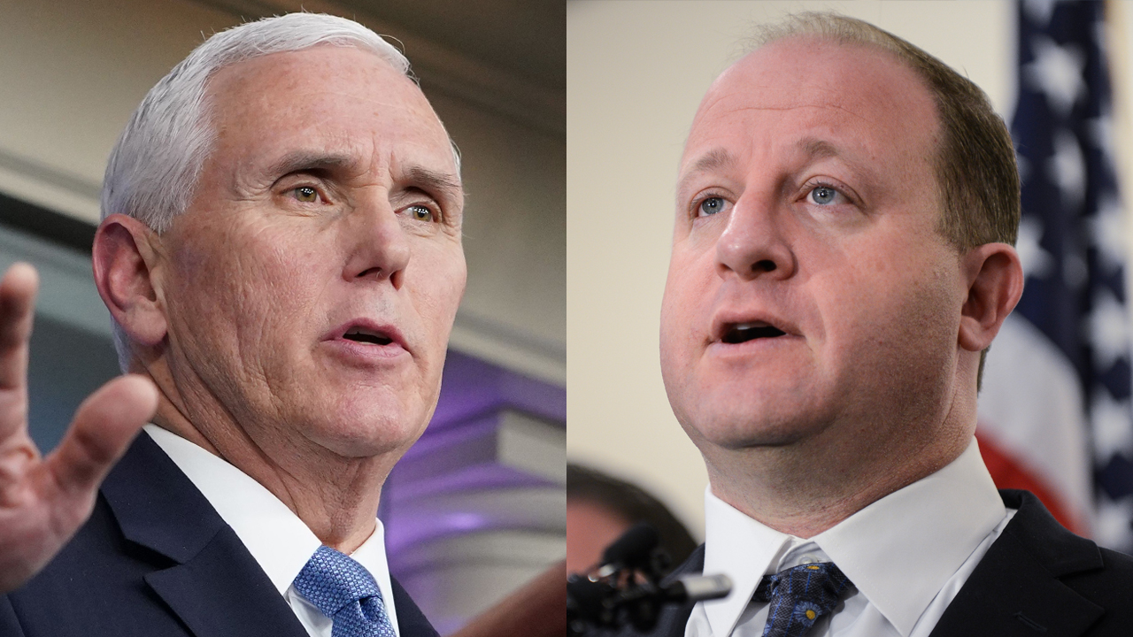 Vice President Mike Pence and Colorado Gov. Jared Polis