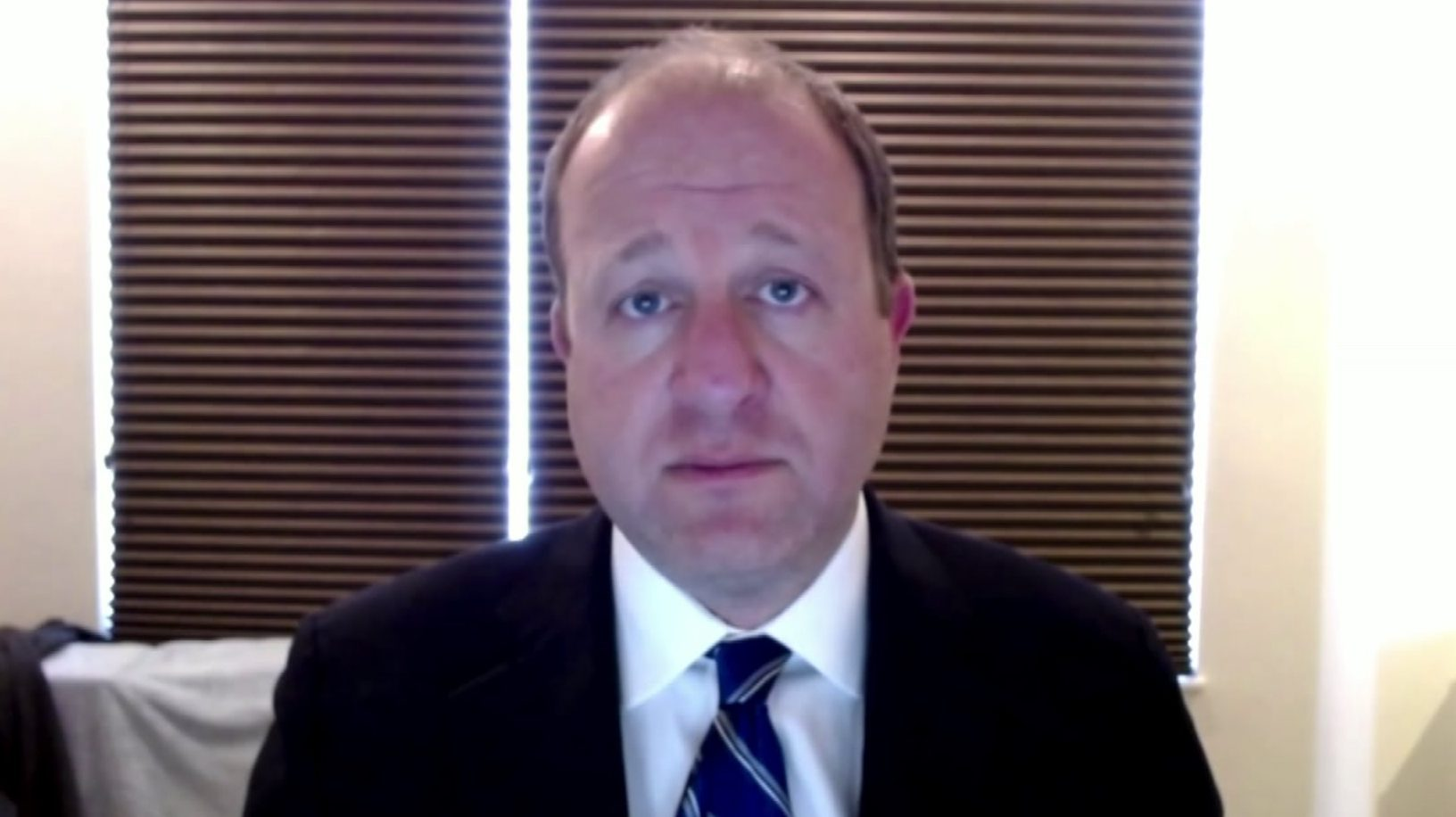 Gov. Jared Polis in an interview over Skype on April 7, 2020.