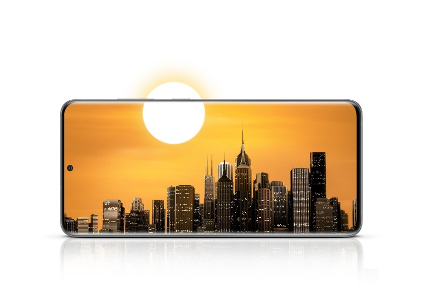 Galaxy S20 Ultra seen from the front in landscape mode with a city skyline onscreen. The sun in the sky is half on the display and half outside the display to show how the all day battery can outlast your day