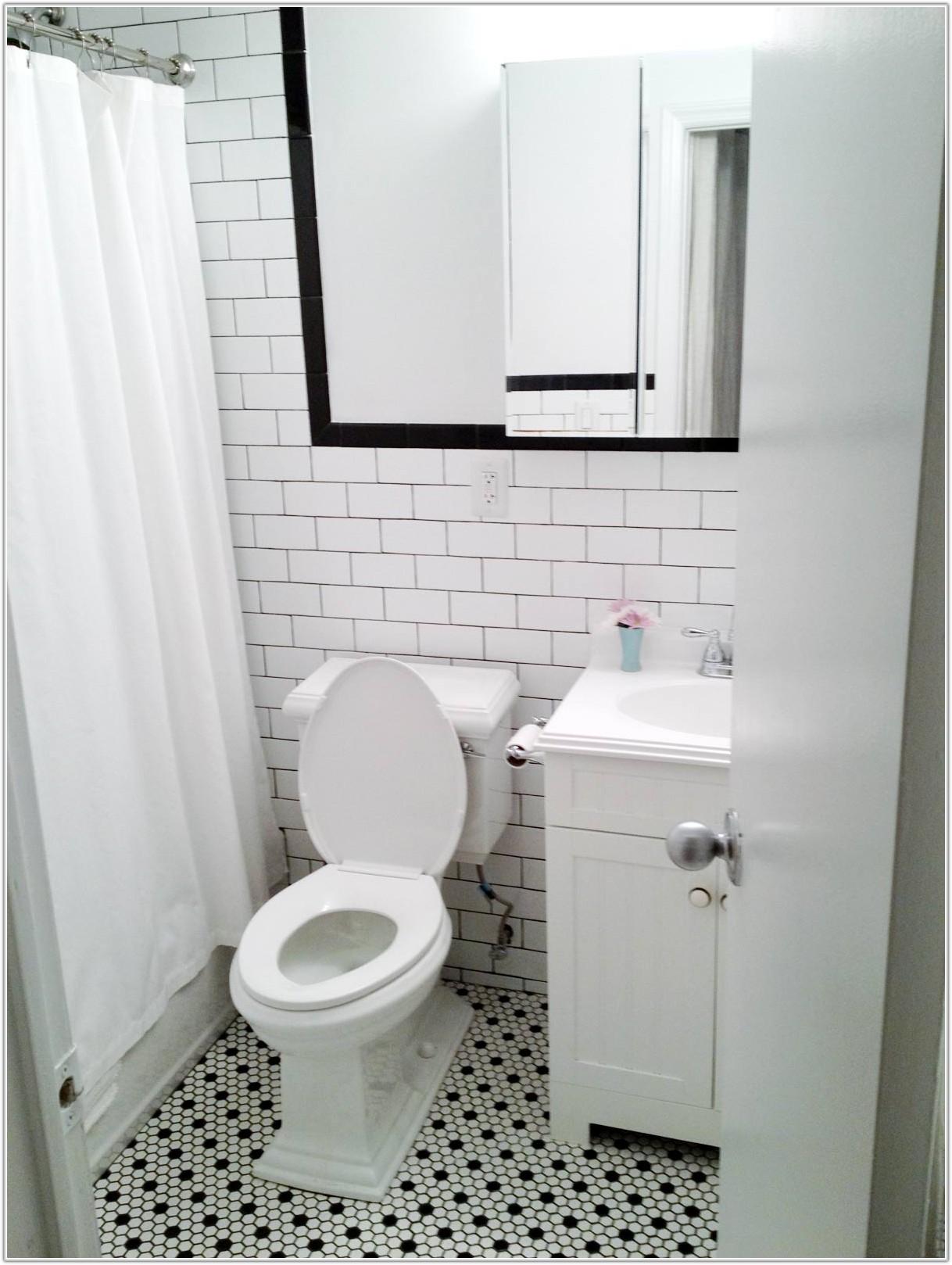 White Floor Tile In Bathroom