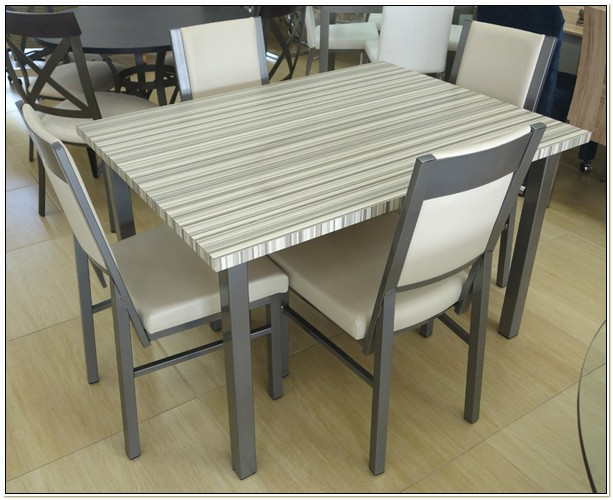 Amisco Glass Table And Chairs