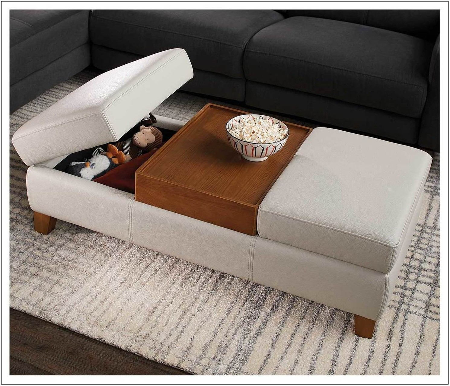 Living Room With Ottoman And Coffee Table