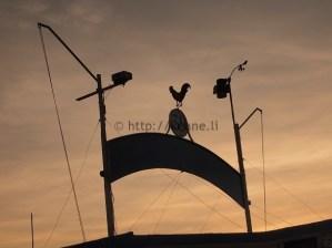 Sign against the setting sun along Rimini beach