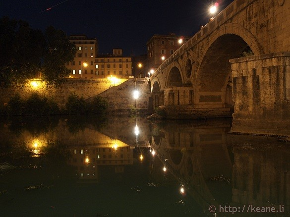 Summer Nights in Rome - The Tevere and an illuminated bridge