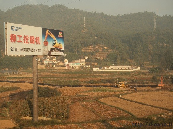 Construction site and billboard on the road from Kunming to Dali