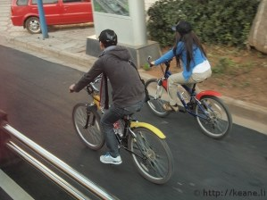 Bicyclists on the road in Lijiang