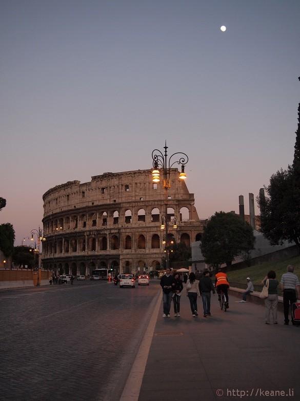 Via dei Fori Imperiali - Colosseo and nearly full moon