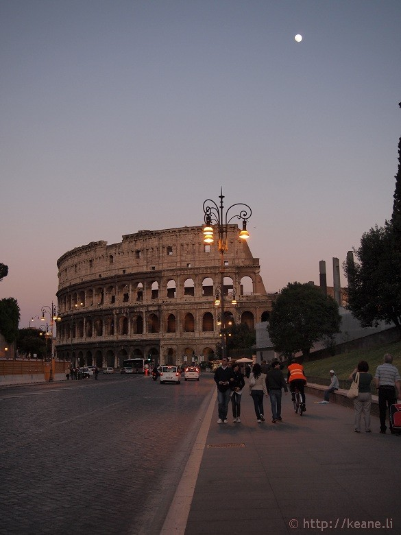 Via dei Fori Imperiali - Colosseo and nearly full moon
