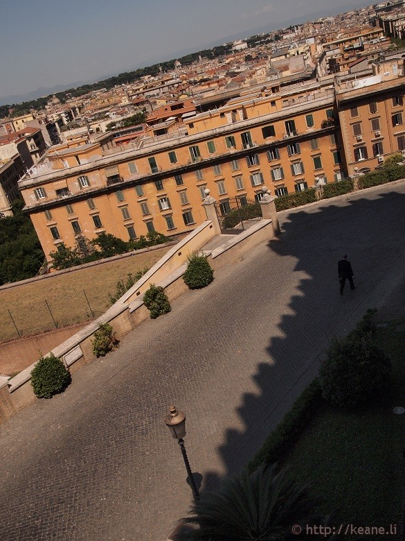 Man walking alone outside the Vatican Museums