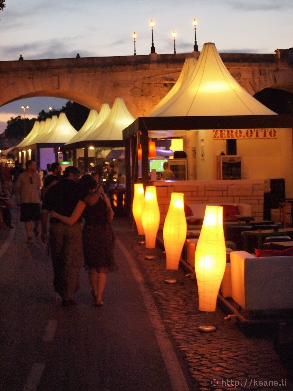 Summer Nights in Rome - Couple walking along the Tevere