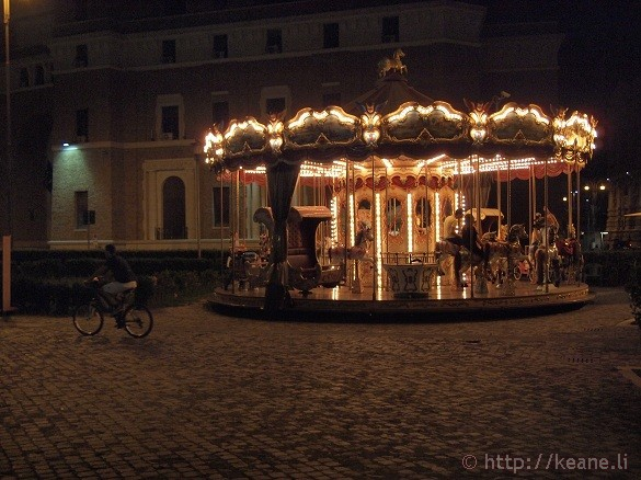 Summer Nights in Rome - Couple riding the carousel