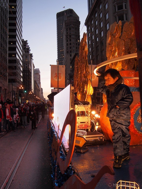 Boy on AT&T float in Chinese New Year parade