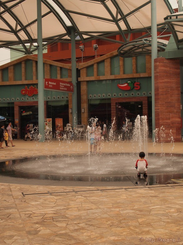 Sentosa Island in Singapore - Boy in front of fountain at Chili's