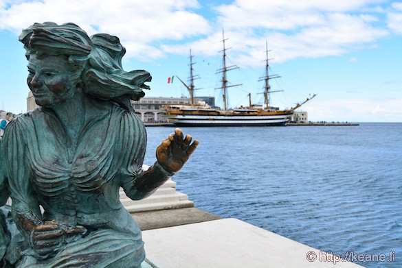 Le Sartine Statue and Historic Ship Docked in Trieste