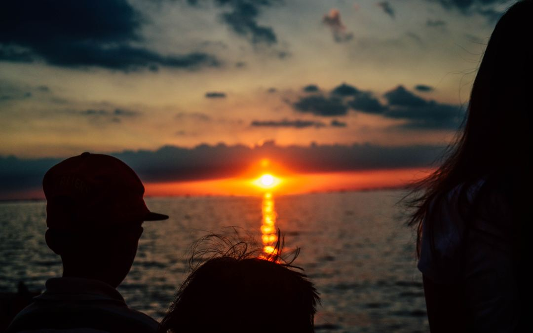 Photo of children watching the sun set