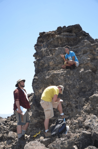 Team Utah students describing the lava in Ice Springs Volcanic Field. Photo source: http://woostergeologists.scotblogs.wooster.edu/2013/06/13/serious-geologizing-in-utah/