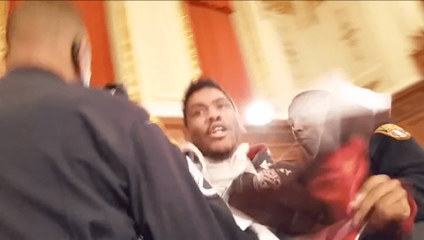 Cleveland Cops Assault, Arrest, Interrogate Peaceful Protester For Holding Tamir Rice Photo at Public Meeting