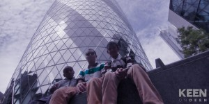 boys sitting in front if the gherkins tower