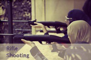 girl aiming rifle guns
