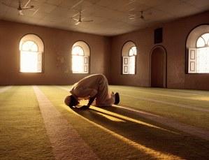 Muslim man prays