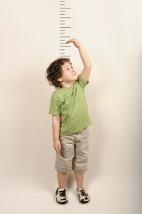 boy measuring his height
