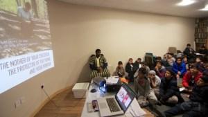 boys looking at presentation screen