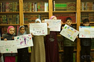 children holding poster they made